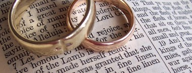 a-pair-of-wedding-rings-sit-on-an-open-bible-marriage-wedding